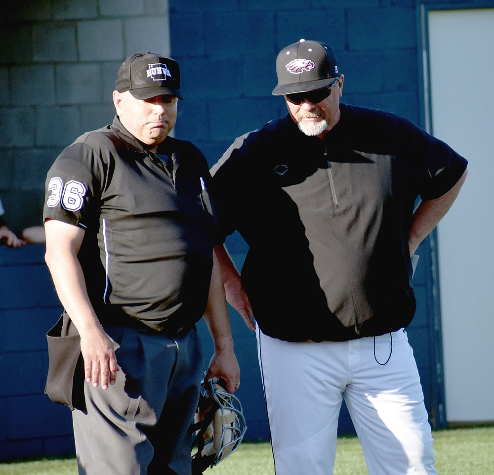 """MARK HUMPHREY  ENTERPRISE-LEADER/Huntsville baseball coach Greg Harris (left), shown seconds after a vigorous protest contesting an infield single by Farmington's Tate Sutton in the fifth inning, did not debate a """"balk"""" ruling in the top of the seventh that occurred prior to contact made by the Eagles' Luke Eaton erasing a base hit and potential RBI that would have put Huntsville ahead. With the """"balk ruling"""" enforced a fly ball on the next pitch ended the inning and the game remained tied 4-4. Farmington eventually won 5-4 walking in a run with the bases loaded in the ninth."""