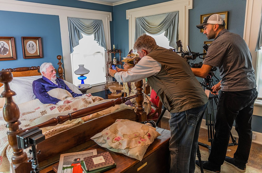 "Bill Rogers and Jennica Schwartzman work on a scene from ""Indians, Outlaws, Marshals and the Hangin' Judge"" as filmmaker Larry Foley (standing left) and Hayot Tuychiev, director of photography, capture the moment. (Courtesy Photo/James Brewer)"