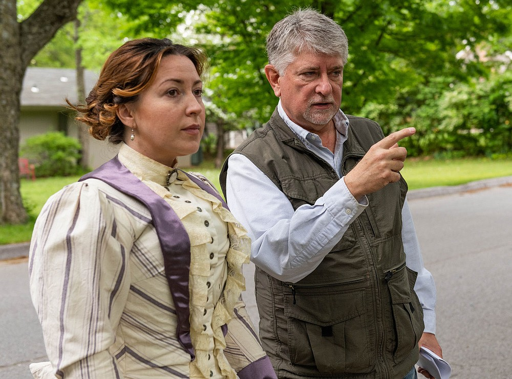 "Filmmaker Larry Foley directs Jennica Schwartzman in a scene from ""Indians, Outlaws, Marshals and the Hangin' Judge"" shot in Fayetteville. (Courtesy Photo/James Brewer)"