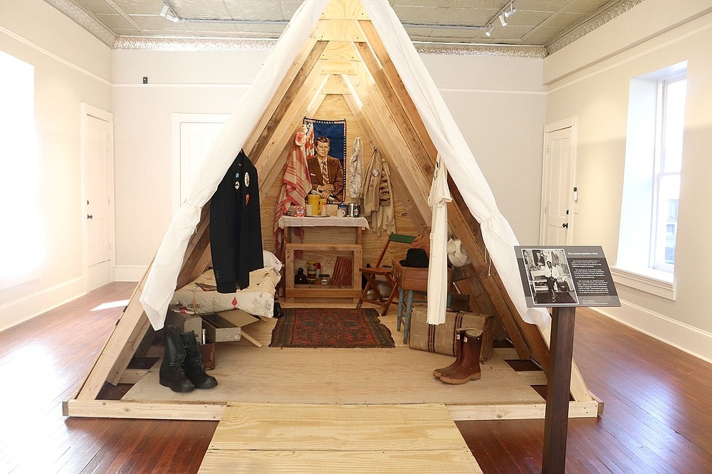 LYNN KUTTER ENTERPRISE-LEADER This wood tent is a replica of the temporary shelters constructed for Resurrection City and the 1968 Poor People's Campaign in Washington, D.C. A new exhibit at The Museum Gallery at Historic Cane Hill tells about the campaign to draw attention to poverty.