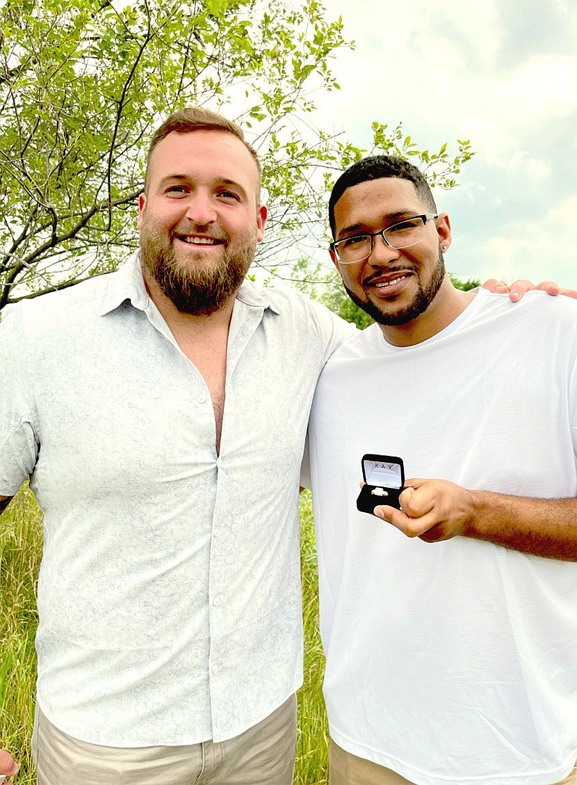"""Submitted Photo/Denver Broncos guard Dalton Risner (left) partnered with Kay Jewelers to donate a Now & Forever diamond engagement ring to Will Hampton, of Wakarusa, Kan., who presented it to his finance, Stephanna Barnette. The couple, parents of 9-year-old Kaden, who's battled Leukemia ALL and is now in remission, met Risner while he was attending Kansas State. Risner took on a role as a """"big brother"""" to Kaden and wanted to celebrate the couple's engagement."""