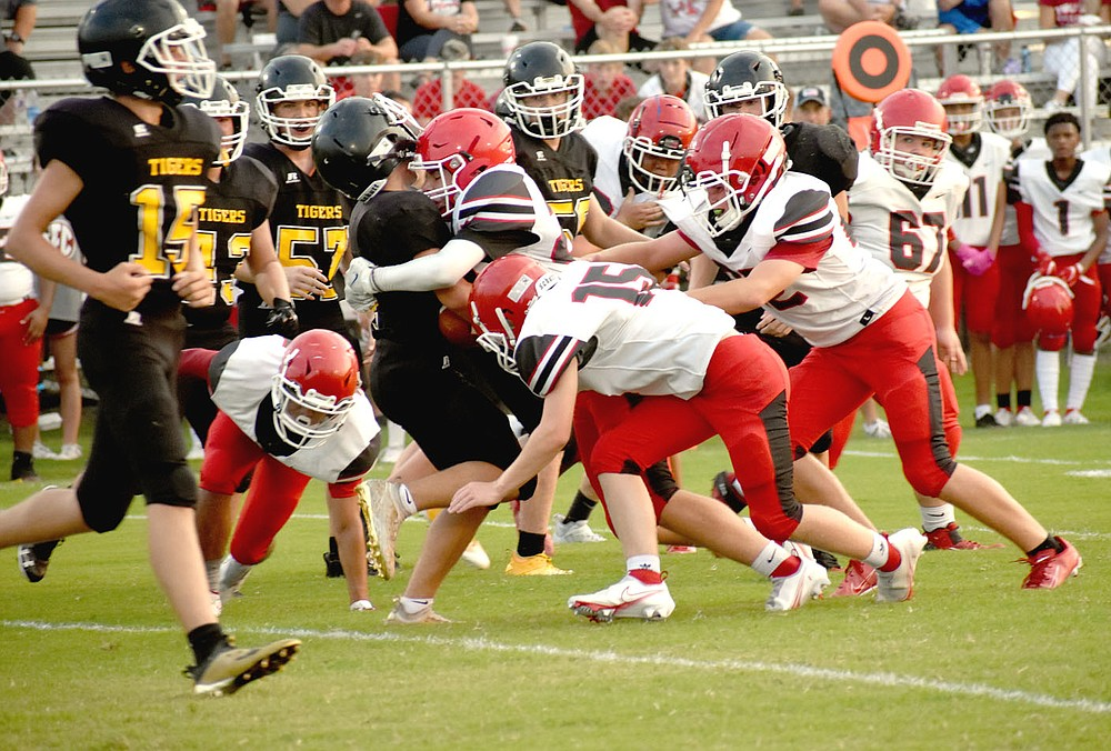 "MARK HUMPHREY  ENTERPRISE-LEADER/Farmington middle linebacker Morgan Schader lowers the boom on a Prairie Grove ball carrier during Thursday's junior high clash in the ""Battle of 62"" football rivalry. The junior Cardinals won on the road at Prairie Grove, 24-22."