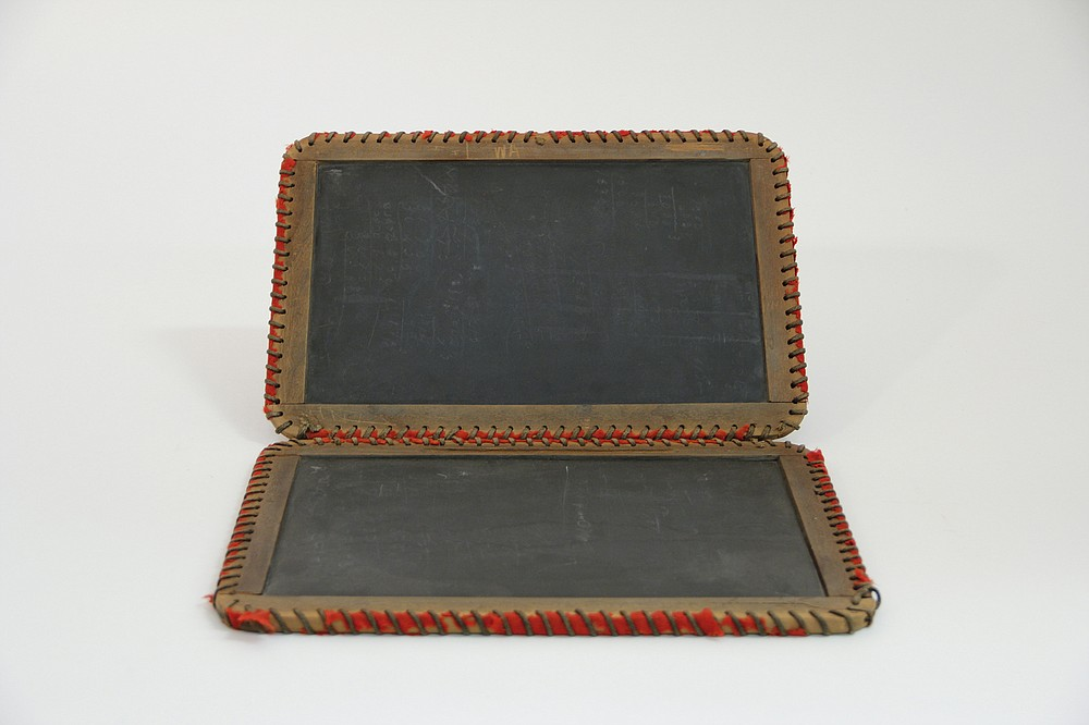 Students used wrote on slates with chalk to work on math problems or practice penmanship. (National Museum of American History)