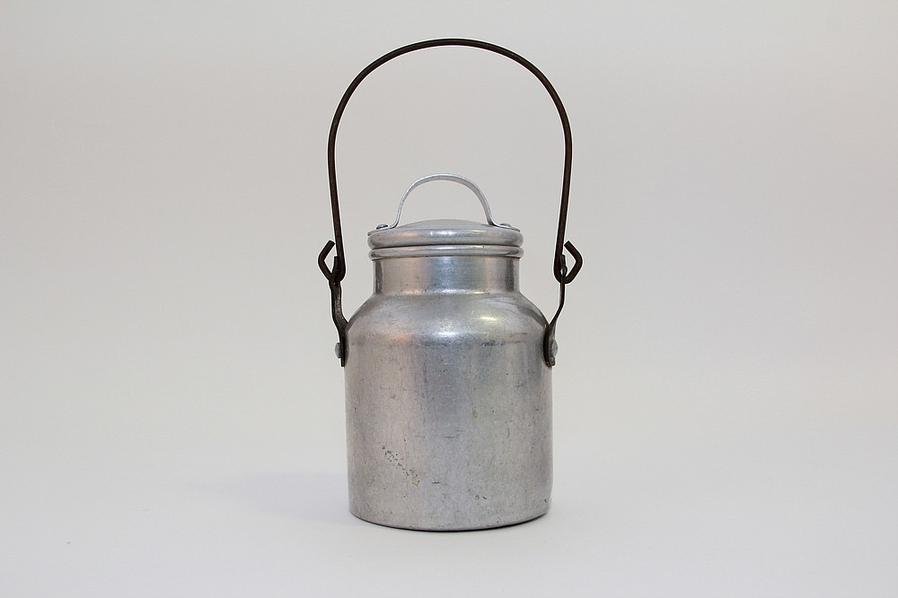 Kids at country schools brought food to eat at school. They would have used this aluminum lunch pail for milk or soup. (National Museum of American History)