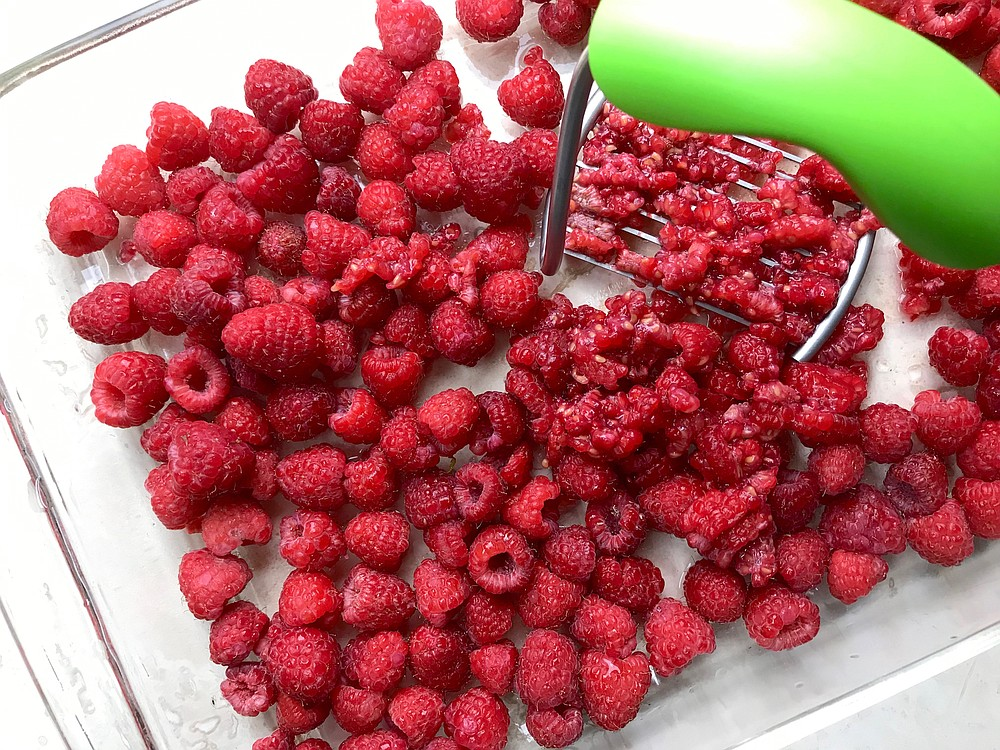 Fresh raspberries are mashed in a single layer for freezer jam. (Arkansas Democrat-Gazette/Kelly Brant)