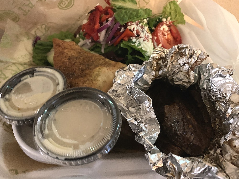 The Chargrilled Lamb Feast from Taziki's includes a Greek salad, choice of rice or potatoes and a toasted pita chip. (Arkansas Democrat-Gazette/Eric E. Harrison)
