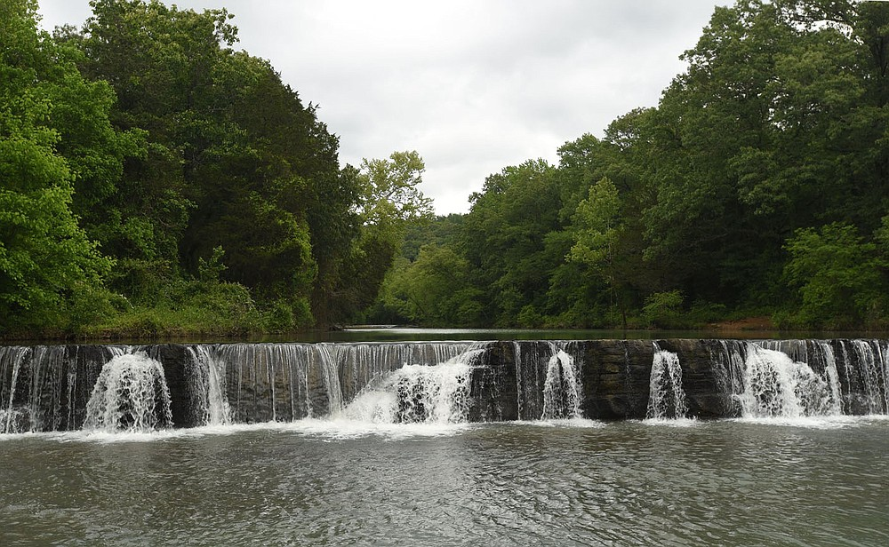 Natural Dam waterfall appears to be totally man-made, but it it totally natural. (NWA Democrat-Gazette/Flip Putthoff)