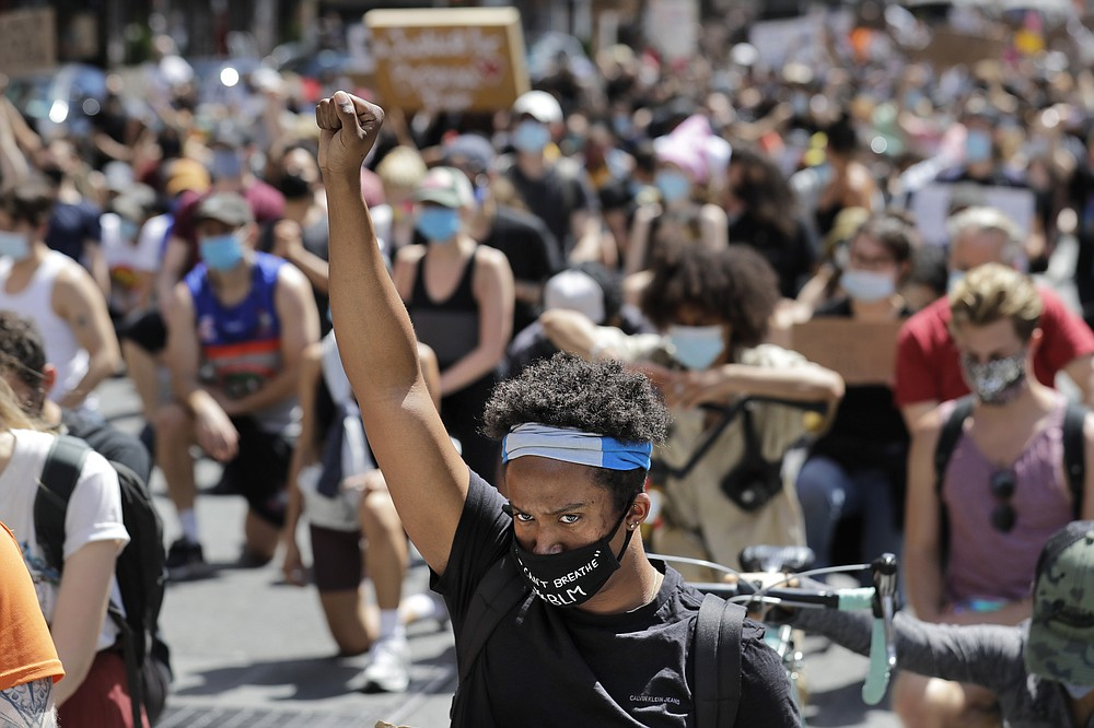 Protesters march through the streets of Manhattan, New York, Sunday, June 7, 2020. New York City lifted the curfew spurred by protests against police brutality ahead of schedule Sunday after a peaceful night, free of the clashes or ransacking of stores that rocked the city days earlier. (AP Photo/Seth Wenig)