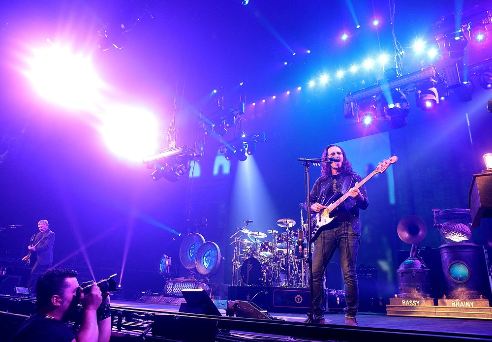 "Alex Lifeson (from left) Neil Peart and Geddy Lee of the band Rush perform during their ""R40 Live: 40th Anniversary Tour 2015"" in Philadelphia.  (AP)"