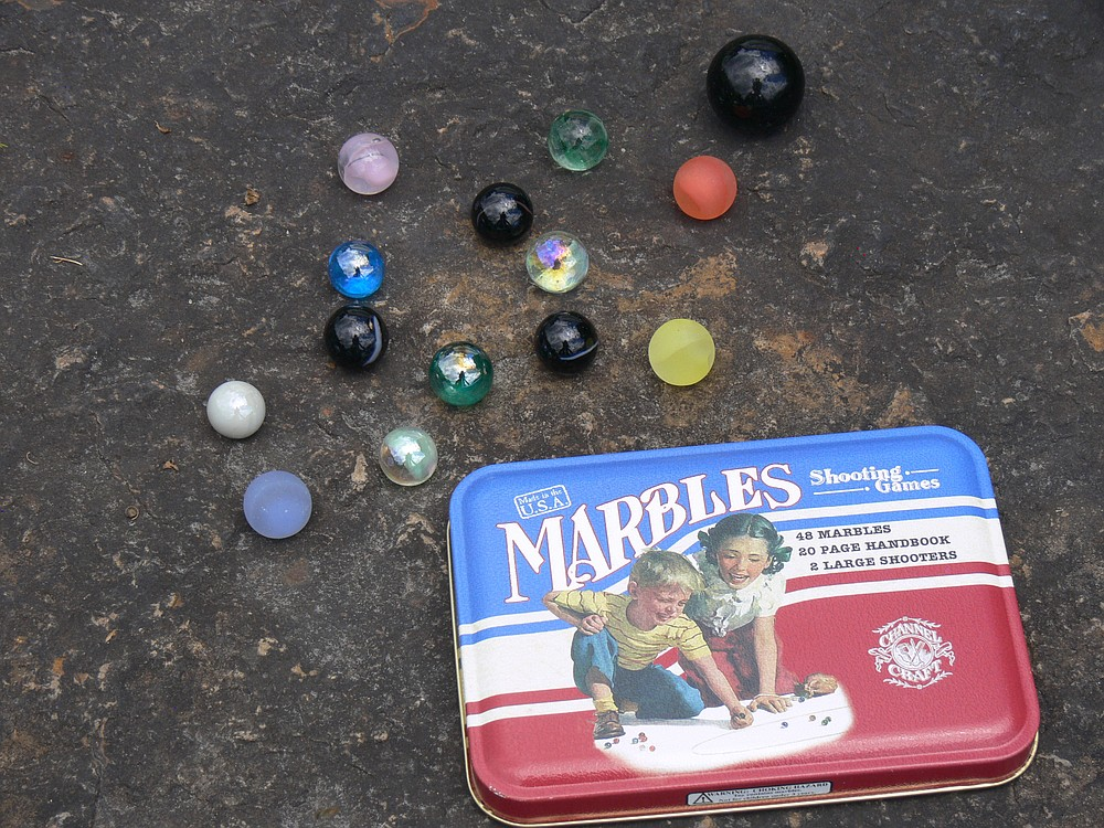 Marbles are sold in decorative tins as heritage playthings at the Toy Chest in Hot Springs. (Special to the Democrat-Gazette/Jerry Butler)