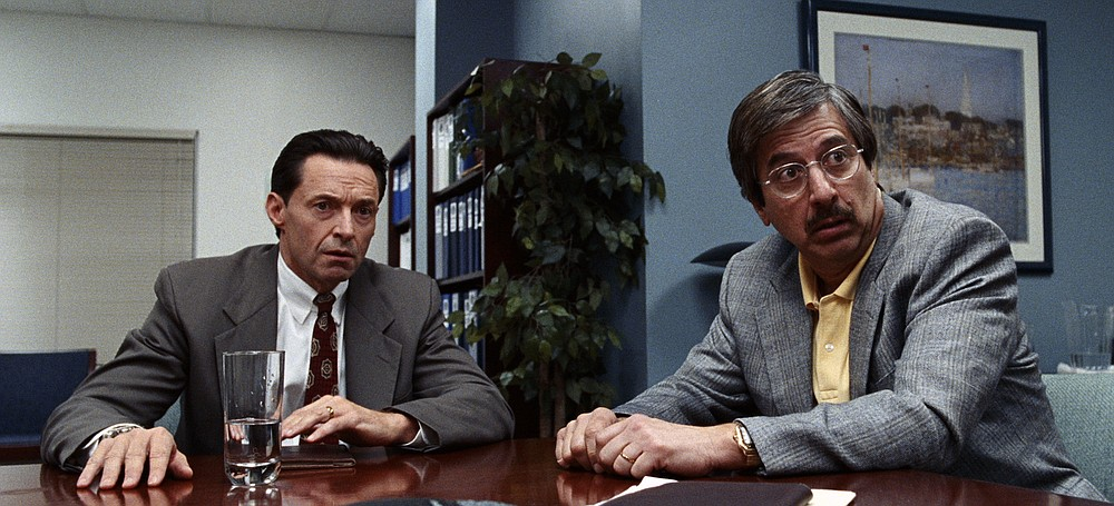"""This image released by HBO shows Hugh Jackman, left, and Ray Romano in a scene from """"Bad Education."""" (HBO via AP)"""
