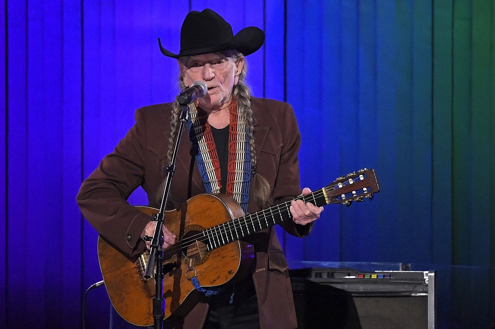 Music legend Willie Nelson and a bunch of friends are getting together for a livestream concert to benefit the working people of Austin, Texas, who were affected by the covid-19 shutdowns. See it at 8 p.m. Wednesday at anightforaustin.com.  (AP file photo/Mark J. Terill)