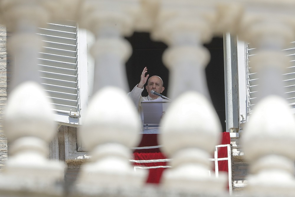 FILE - In this Sunday, June 7, 2020 file photo, Pope Francis delivers his blessing as he recites the Angelus noon prayer from the window of his studio overlooking St.Peter's Square, at the Vatican. Pope Francis and cardinals have preached, tweeted and spoken out about his death, and the Vatican's communications juggernaut has gone into overdrive to draw attention to the cause. George Floyd's killing at the hands of a white police officer and the global protests that erupted to denounce police brutality and racism might normally have drawn a muted diplomatic response from the Holy See. (AP Photo/Andrew Medichini, File)