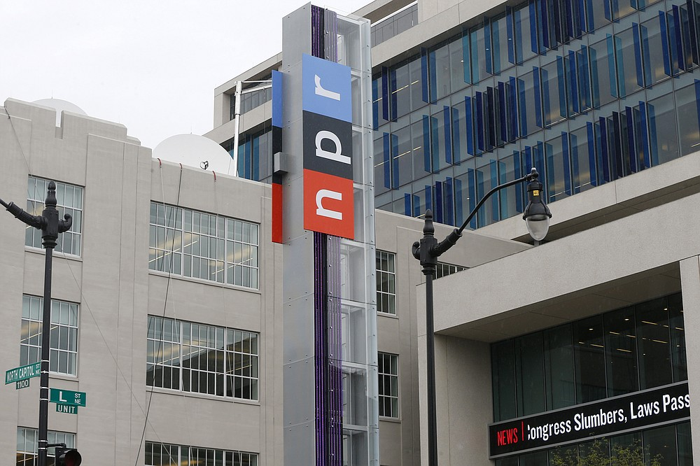 FILE - This April 15, 2013 file photo shows the headquarters for National Public Radio on North Capitol Street in Washington. On Friday, June 12, 2020, The Associated Press reported on stories circulating online incorrectly asserting NPR wants people to burn books written by white people. A story published on June 6 on NPR's website never mentions book burning. The piece recommends broadening and diversifying personal reading lists to go beyond white authors. (AP Photo/Charles Dharapak, File)