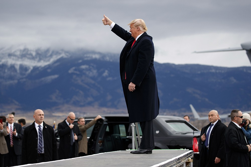 FILE - In this Nov. 3, 2018, file photo President Donald Trump arrives for a campaign rally at Bozeman Yellowstone International Airport in Belgrade, Mont. (AP Photo/Evan Vucci, File)
