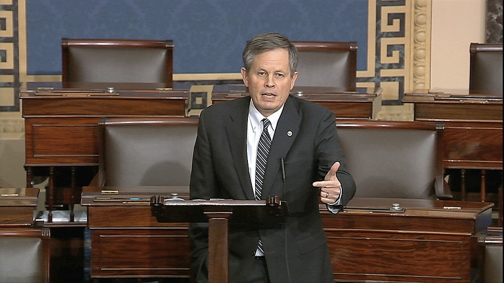 FILE - In this Tuesday, March 24, 2020 file image from video, Sen. Steve Daines, R-Mont., speaks on the Senate floor at the U.S. Capitol in Washington. Daines faces a challenge from Montana Gov. Steve Bullock in the Nov. 3 election. (Senate Television via AP,File)