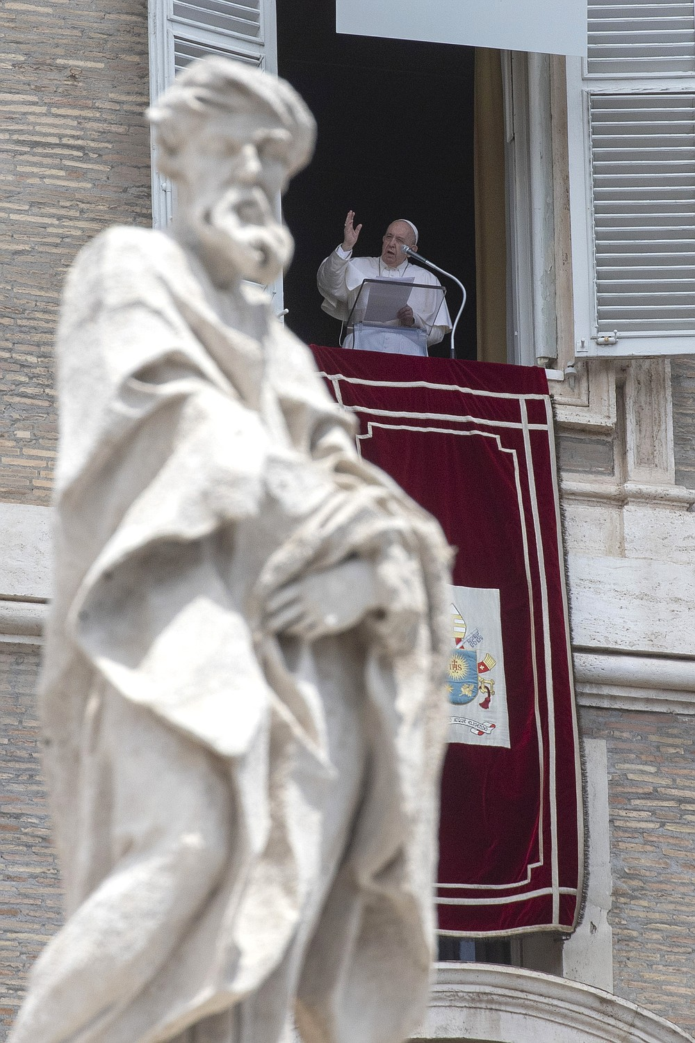 Pope Francis delivers his Angelus blessing from the window of his studio overlooking St. Peter's Square, at the Vatican, Sunday, June 14, 2020. (AP Photo/Alessandra Tarantino)