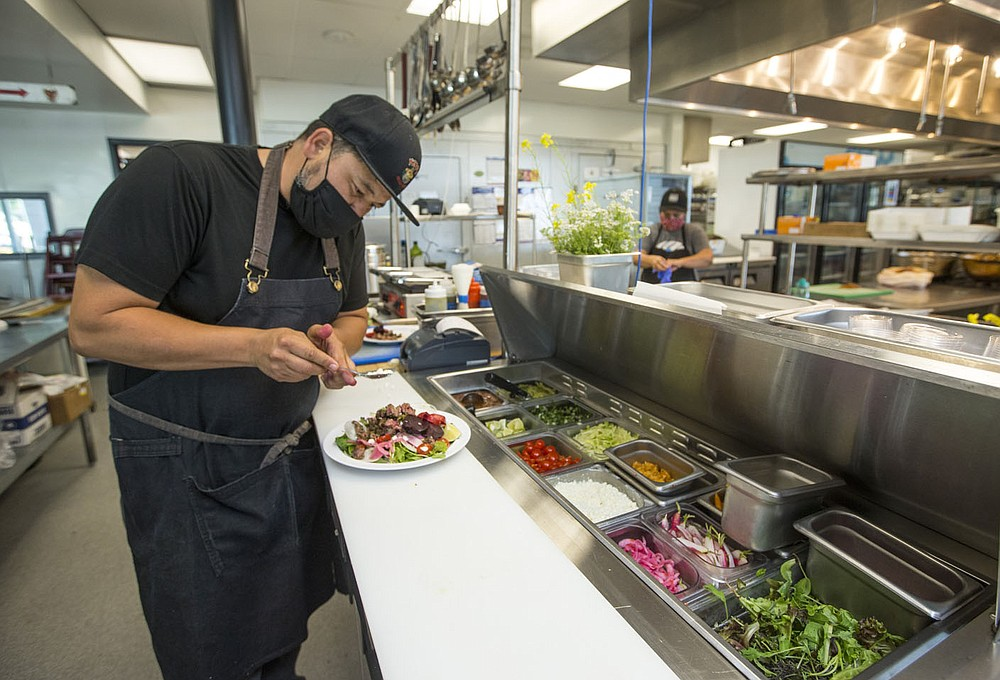 Rafael Rios prepares a steak salad Tuesday, June 16, 2020, using only produce from Rios Family Farm at Yeyo's Mexican Grill in Bentonville. Go to nwaonline.com/photos to see more photos. (NWA Democrat-Gazette/Ben Goff)