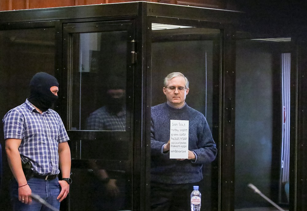 Paul Whelan, a former U.S. marine who was arrested for alleged spying, listens to the verdict in a courtroom at the Moscow City Court in Moscow, Russia, Monday, June 15, 2020. The Moscow City Court on Monday convicted Paul Whelan on charges of espionage and sentenced him to 16 years in maximum security prison colony. Whelan has insisted on his innocence, saying he was set up. The U.S. Embassy has denounced Whelan's trial as unfair, pointing that no evidence has been provided. (Sofia Sandurskaya, Moscow News Agency photo via AP)