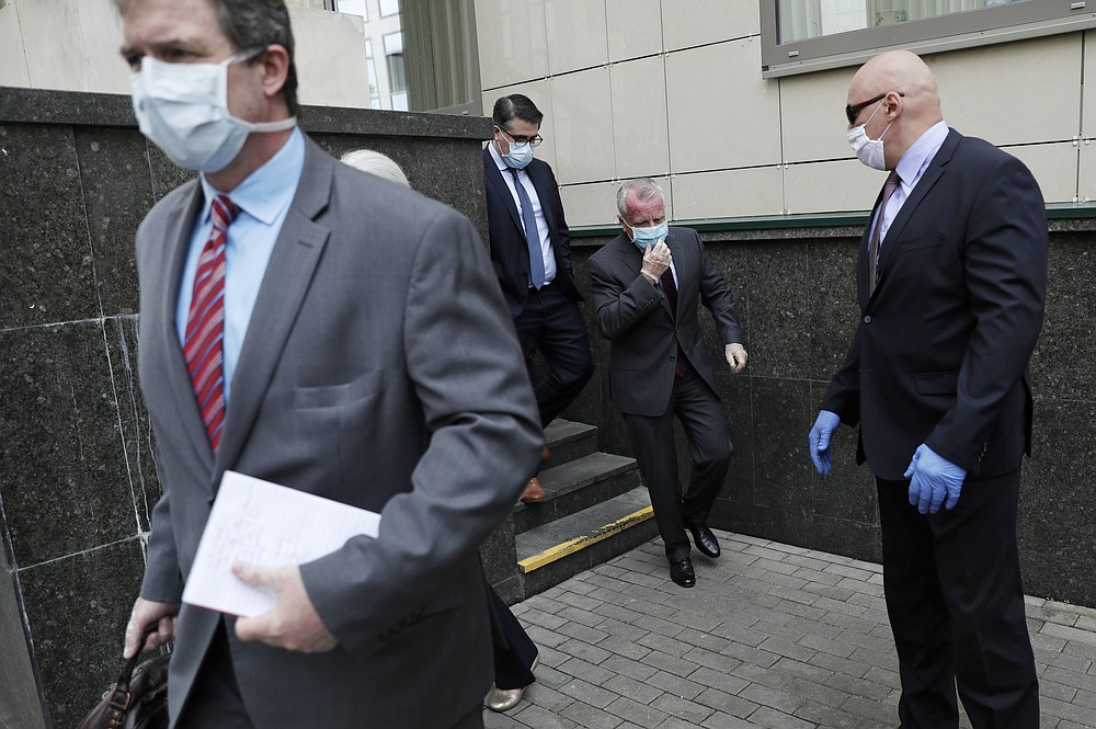 U.S. Ambassador to Russia John Sullivan, 2nd right, leaves the Moscow City Court building after the verdict announcement for American Paul Whelan in Moscow, Russia, Monday, June 15, 2020. The Moscow City Court on Monday convicted Paul Whelan on charges of espionage and sentenced him to 16 years in maximum security prison colony. Whelan has insisted on his innocence, saying he was set up. The U.S. Embassy has denounced Whelan's trial as unfair, pointing that no evidence has been provided. (AP Photo/Pavel Golovkin)