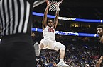 Arkansas forward Reggie Chaney (35) dunks during a March 11 basketball game against Vanderbilt at Bridgestone Arena in Nashville, Tenn. Chaney has entered his name into the transfer portal. - Photo by Charlie Kaijo of NWA Democrat-Gazette