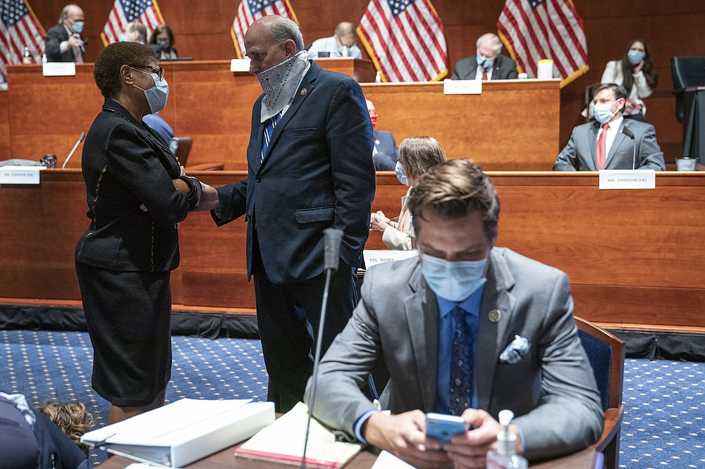 Rep. Karen Bass, D-Calif., left, speaks with Rep. Louie Gohmert, R-Texas, during a House Judiciary Committee markup of the Justice in Policing Act of 2020 on Capitol Hill in Washington, Wednesday, June 17, 2020. (Sarah Silbiger/Pool via AP)