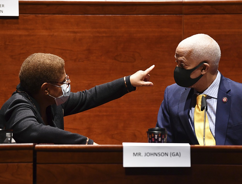 Rep. Karen Bass, D-Calif. left, speaks with Rep. Hank Johnson, D-Ga., during a House Judiciary Committee markup of the Justice in Policing Act of 2020 on Capitol Hill in Washington, Wednesday, June 17, 2020. (Kevin Dietsch/Pool via AP)