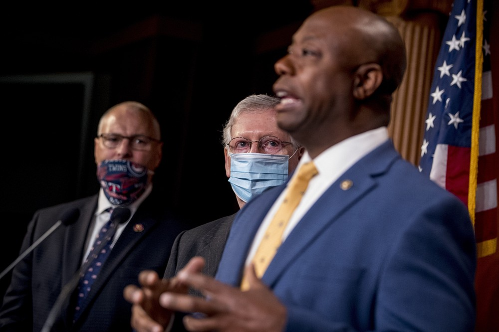Sen. Tim Scott, R-S.C., right, accompanied by Senate Majority Leader Mitch McConnell of Ky., second from right, and other Republican senators speaks at a news conference to announce a Republican police reform bill on Capitol Hill, Wednesday, June 17, 2020, in Washington. (AP Photo/Andrew Harnik)