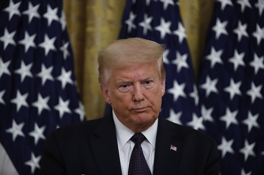 """President Donald Trump speaks about the PREVENTS """"President's Roadmap to Empower Veterans and End a National Tragedy of Suicide,"""" task force, in the East Room of the White House, Wednesday, June 17, 2020, in Washington. (AP Photo/Alex Brandon)"""