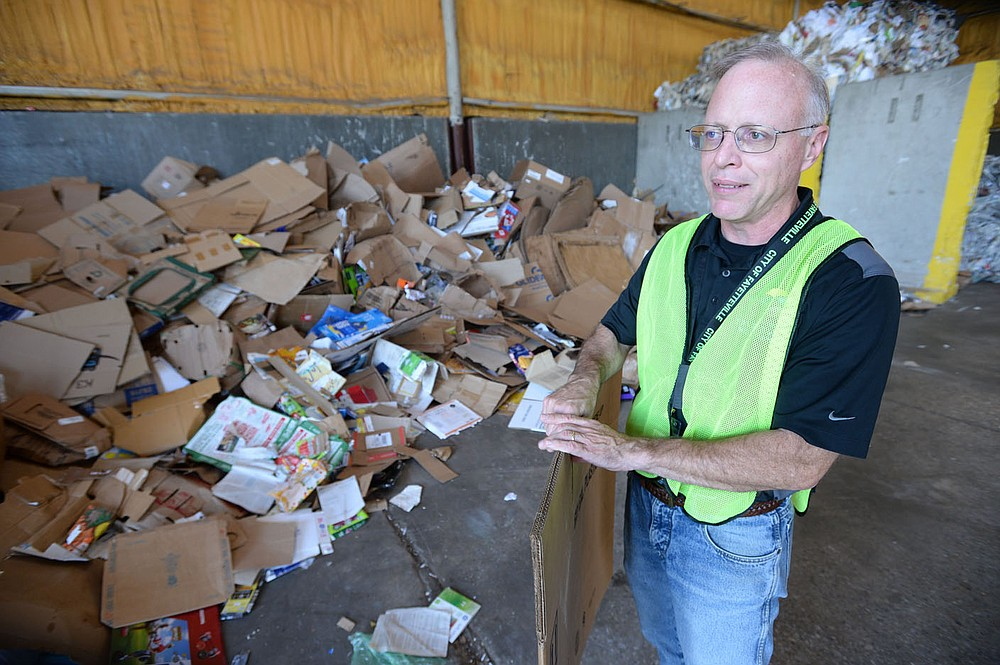 Brian Pugh, Waste Reduction Coordinator for the city of Fayetteville's Recycling and Trash Collection Division, speaks Friday, June 19, 2020, near a pile of corrugated cardboard at the division's facility. Recycling collection during suspension of the curbside program was about 79% of what it was from March to June last year. The city's curbside service resumes Monday.Visit nwaonline.com/200621Daily/ for today's photo gallery. (NWA Democrat-Gazette/Andy Shupe)
