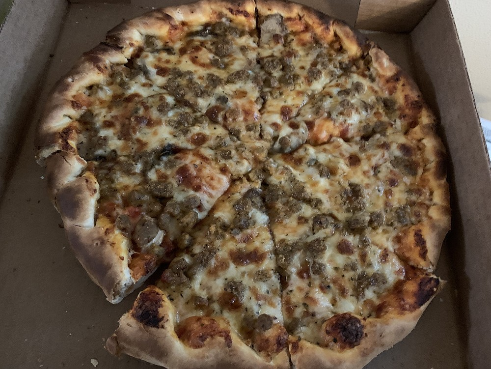 The toppings are thickly applied over a layer of red sauce and puffy crust on our medium Italian sausage and mushroom pizza from the new Old Mill Pizza in North Little Rock.  (Arkansas Democrat-Gazette/Eric E. Harrison)