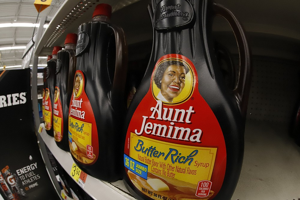 Bottles of Aunt Jemima Original Syrup are displayed on a grocery store shelf.  (AP/Gene J. Puskar)