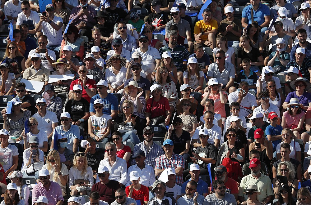 Fans watch a tennis match between Serbia's Novak Djokovic and Germany's Alexander Zverev, of the Adria Tour charity tournament in Belgrade, Serbia, Sunday, June 14, 2020. (AP Photo/Darko Vojinovic)