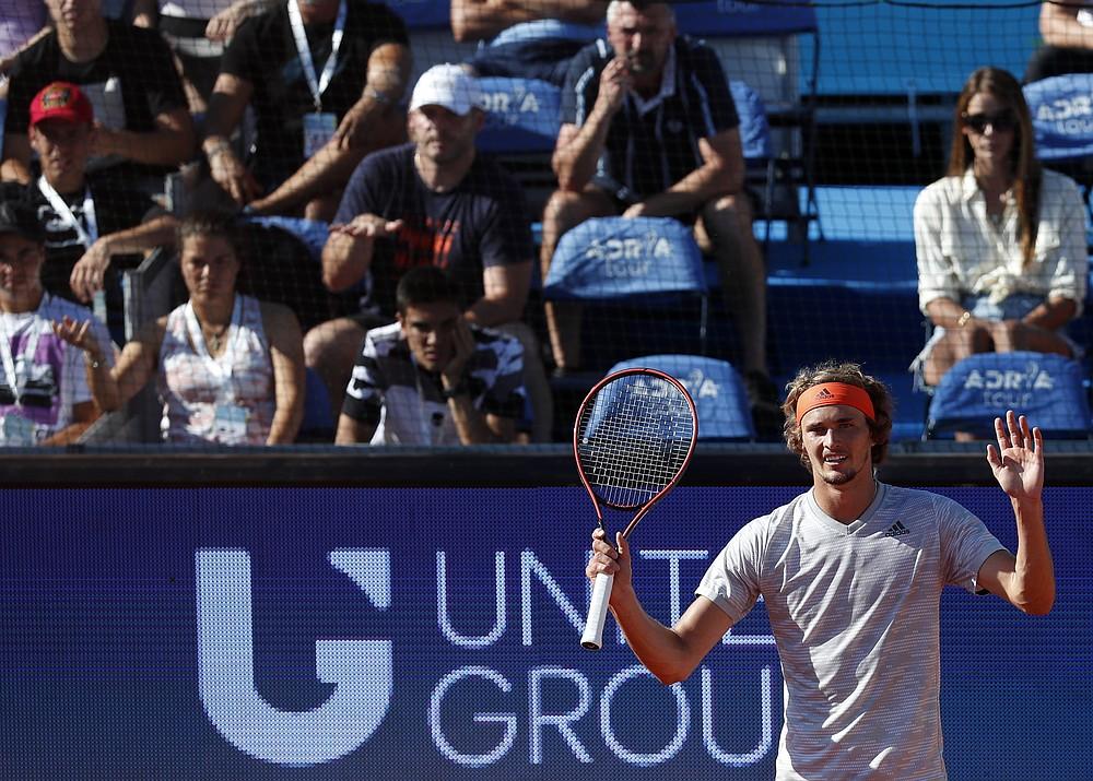 Germany's Alexander Zverev reacts during the match against Serbia's Novak Djokovic, of the Adria Tour charity tournament in Belgrade, Serbia, Sunday, June 14, 2020. (AP Photo/Darko Vojinovic)