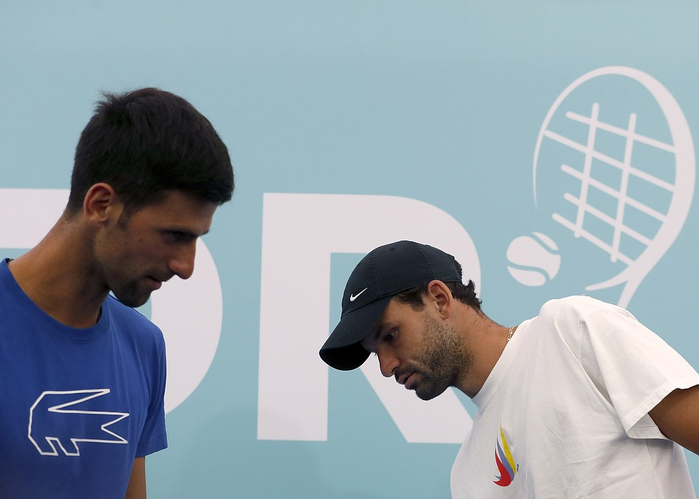 In this photo taken on Friday, June 12, 2020, Serbia's Novak Djokovic, left, and Bulgaria's Grigor Dimitrov attend a press conference prior a a charity tournament Adria Tour, in Belgrade, Serbia. Dimitrov has tested positive for COVID-19, it is announced Monday June 22, 2020, leading to the cancellation of an exhibition event in Croatia where top-ranked Novak Djokovic was due to play in the final. Organizers said Sunday the exhibition has now been canceled. (AP Photo/Darko Vojinovic)