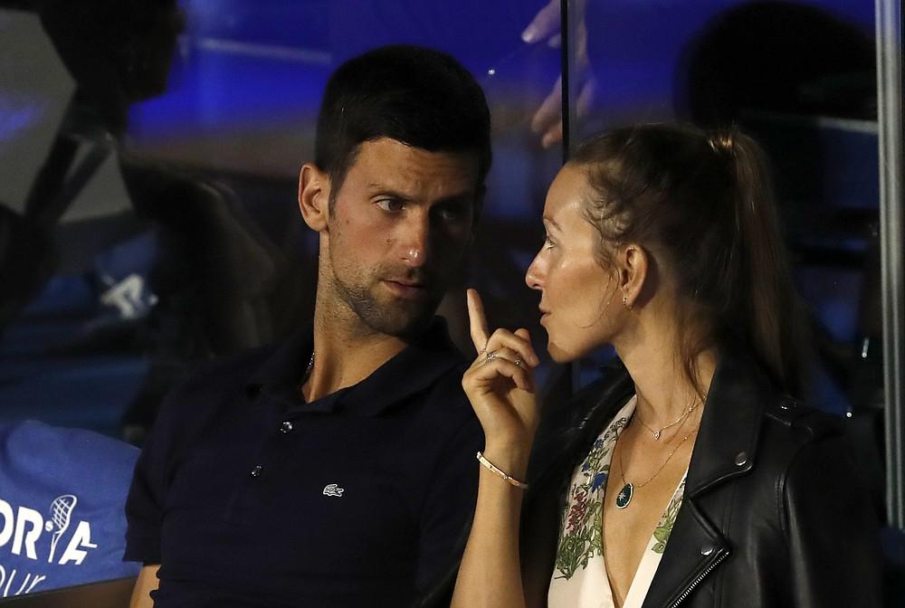 Serbia's Novak Djokovic, left, speaks with his wife Jelena during a final match of the Adria Tour charity tournament, between Austria's Dominic Thiem and Serbia's Filip Krajinovic, in Belgrade, Serbia, Sunday, June 14, 2020. (AP Photo/Darko Vojinovic)