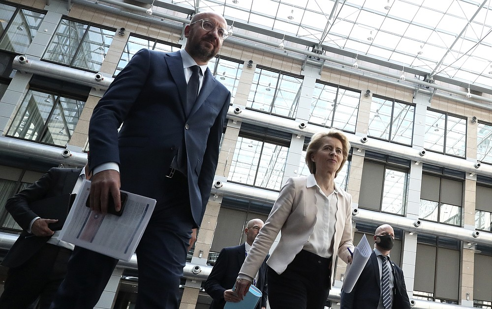 European Council President Charles Michel, left, and European Commission President Ursula von der Leyen arrive for a media conference at the conclusion of an EU-China summit, in video conference format, at the European Council in Brussels, Monday, June 22, 2020. Top European Union officials held talks Monday with Chinese President Xi Jinping and Premier Li Keqiang at a time of rising tensions between two major trading partners over the fallout from the coronavirus crisis and Beijing's increasing control over Hong Kong. (Yves Herman, Pool Photo via AP)