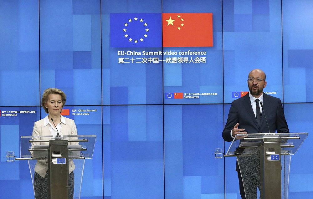 European Council President Charles Michel, right, and European Commission President Ursula von der Leyen participate in a media conference at the conclusion of an EU-China summit, in video conference format, at the European Council in Brussels, Monday, June 22, 2020. Top European Union officials held talks Monday with Chinese President Xi Jinping and Premier Li Keqiang at a time of rising tensions between two major trading partners over the fallout from the coronavirus crisis and Beijing's increasing control over Hong Kong. (Yves Herman, Pool Photo via AP)