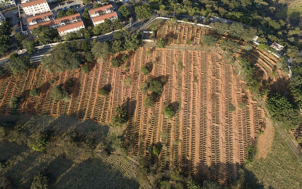 Newly dug, empty graves fill the Sao Luiz cemetery where COVID-19 victims will be buried in Sao Paulo, Brazil, Monday, June 22, 2020. (AP Photo/Andre Penner)