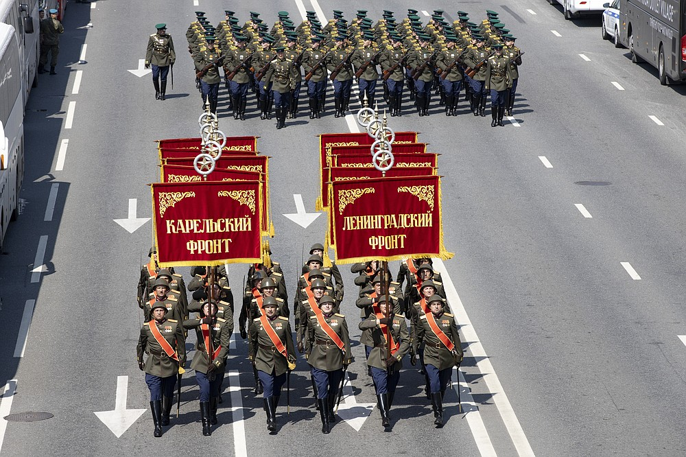 FILE - In this file photo taken on Saturday, June 20, 2020, Russian soldiers wearing WWII-era uniforms march toward Red Square to attend a dress rehearsal for the Victory Day military parade in Moscow, Russia. A massive military parade that was postponed by the coronavirus will roll through Red Square this week to celebrate the 75th anniversary of the end of World War II in Europe, even though Russia is continuing to register a steady rise in infections. (AP Photo/Alexander Zemlianichenko, File)