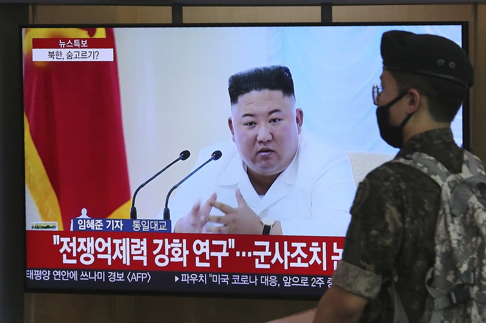 "A South Korean army soldier passes by a TV showing a file image of North Korean leader Kim Jong Un during a news program at the Seoul Railway Station in Seoul, South Korea, Wednesday, June 24, 2020. Kim suspended his military's plans to take unspecified retaliatory action against South Korea, state media said Wednesday, possibly slowing a pressure campaign against its rival amid stalled nuclear negotiations with the Trump administration. The Korean letters read: ""Strengthening deterrence of war."" (AP Photo/Ahn Young-joon)"