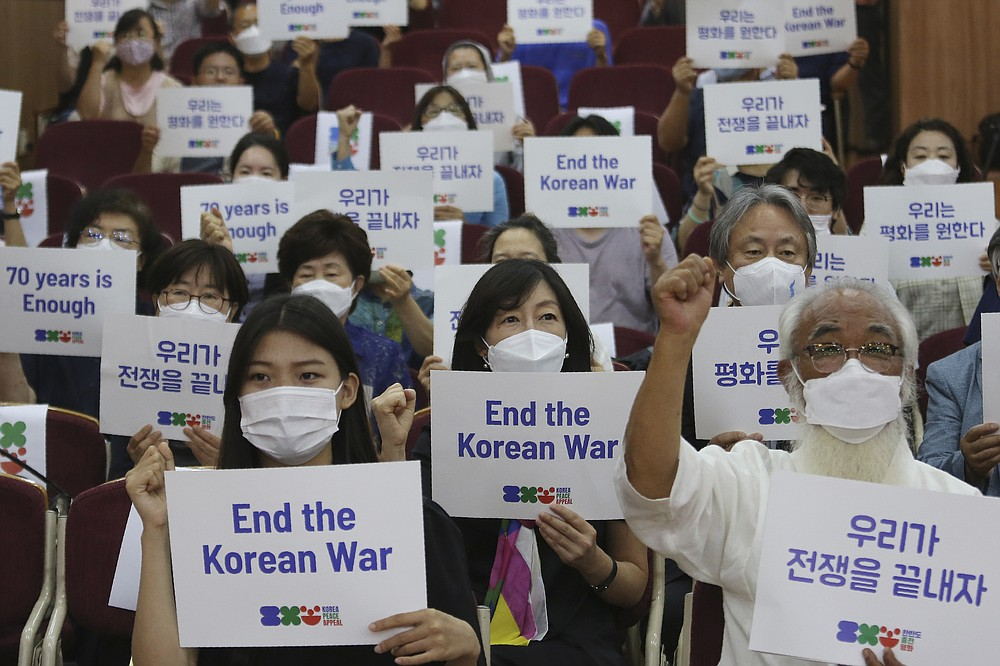 "Anti-war activists shout slogans during a press conference to demand the peace on the Korean peninsula on the eve of the 70th anniversary of the outbreak of the Korean War in Seoul, South Korea, Wednesday, June 24, 2020. North Korean leader Kim Jong Un suspended his military's plans to take unspecified retaliatory action against South Korea, state media said Wednesday, possibly slowing a pressure campaign against its rival amid stalled nuclear negotiations with the Trump administration. The sign reads ""Let us end the war."" (AP Photo/Ahn Young-joon)"