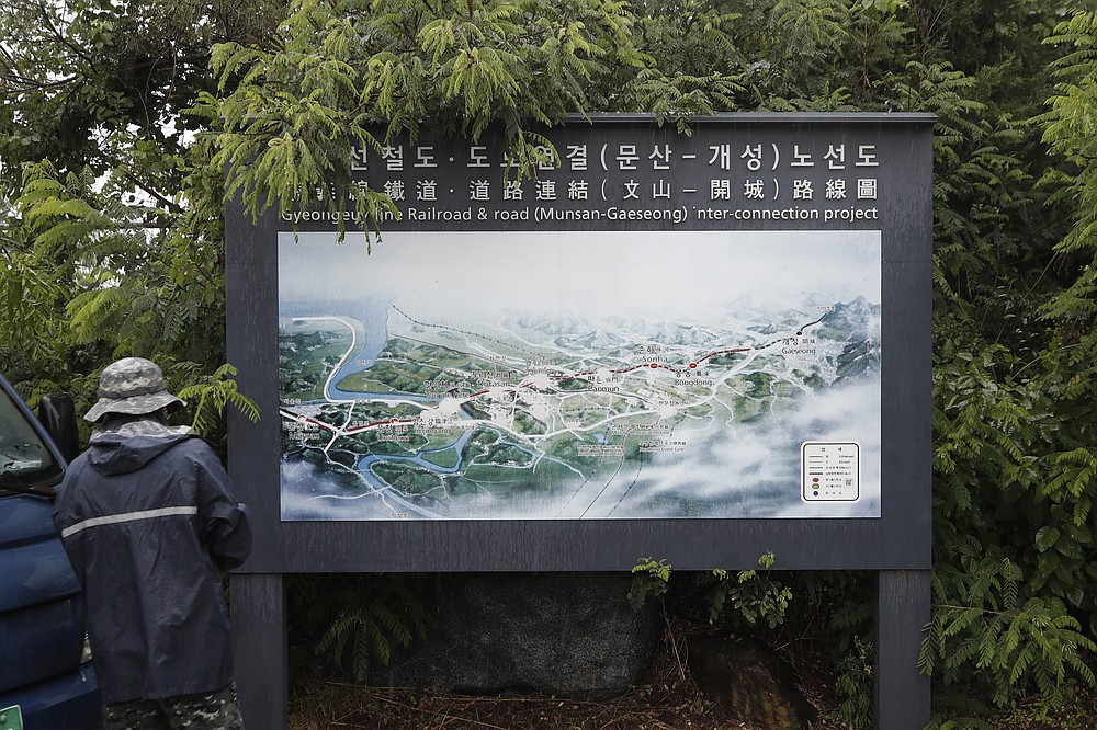 A man walks in front of a map of railroad and road between two Koreas cities, South's Munsan and North's Kaesong, at the Imjingak Pavilion in Paju, South Korea, Wednesday, June 24, 2020. North Korea said Wednesday leader Kim Jong Un suspended a planned military retaliation against South Korea, possibly slowing the pressure campaign it has waged against its rival amid stalled nuclear negotiations with the Trump administration. (AP Photo/Lee Jin-man)