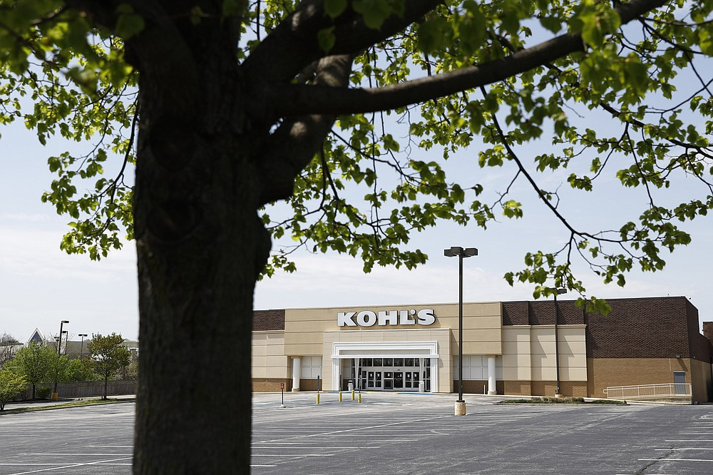 An empty parking lot is seen at a temporarily closed Kohl's department store, Wednesday, April 29, 2020, in Havertown, Pa.  Devastated by the coronavirus, the U.S. economy is sinking.  Now, as some businesses in a few states start to trickle back to work, hopes are beginning to arise that the economy, damaged as it is, might be poised to rebound by the second half of the year.   (AP Photo/Matt Slocum)