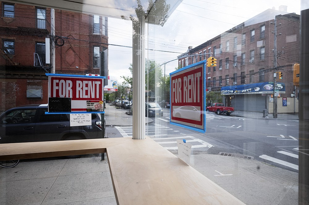 """In this May 12, 2020 photo, a storefront displays """"For Rent"""" signs in the window in the Red Hook neighborhood of the Brooklyn borough of New York. . Some small businesses are closing for good due to the economic crisis brought on by the coronavirus pandemic. (AP Photo/Mark Lennihan)"""