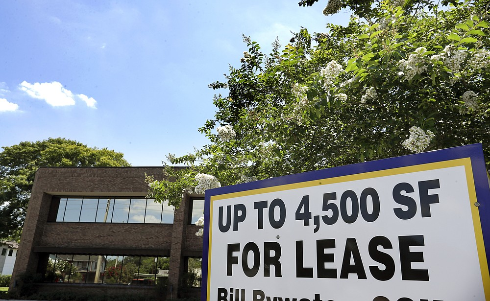 This Monday, June 22, 2020 photo shows a commercial real estate property for lease, in Orlando, Fla.  Many businesses devastated by the coronavirus pandemic are expected to abandon offices and storefronts. The changes are happening because more employees are working from home, and more people are shopping online.(AP Photo/John Raoux)