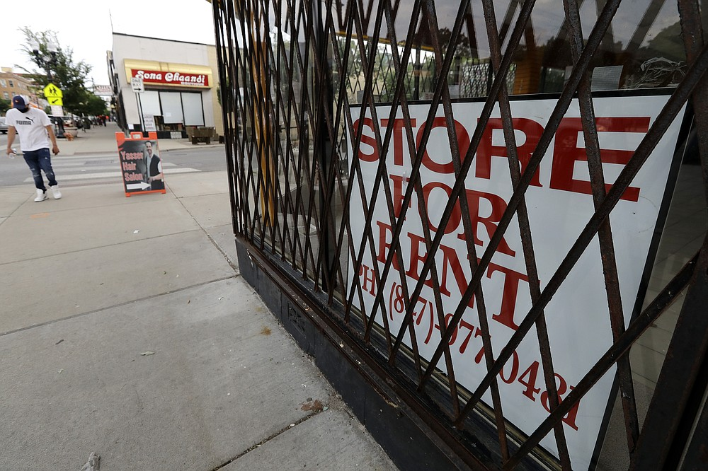 """A """"Store For Rent"""" sign is displayed at a commercial property in Chicago, Saturday, June 20, 2020. The coronavirus has had an impact on the commercial real estate markets. (AP Photo/Nam Y. Huh)"""