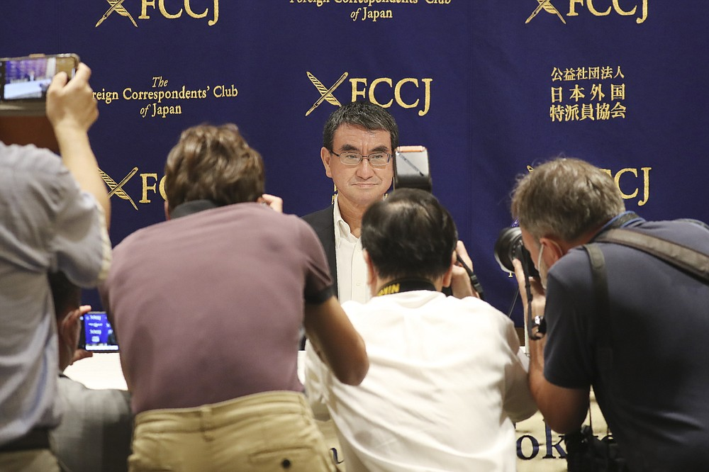 Japanese Defense Minister Taro Kono attends a press conference in Tokyo, Thursday, June 25, 2020. Japan's National Security Council has endorsed plans to cancel the deployment of two costly land-based U.S. missile defense systems aimed at bolstering the country's capability against threats from North Korea, Kono said Thursday. (AP Photo/Koji Sasahara)