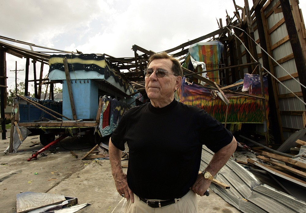 "FILE - In this Sept. 29, 2005 file photo, Blaine Kern, Sr., also known as ""Mr. Mardi Gras,"" looks over the damage by Hurricane Katrina to one of his warehouses at Mardi Gras World in New Orleans. The man known as ""Mr. Mardi Gras"" for helping to convert the annual pre-Lenten celebration into a giant event in New Orleans has died. News outlets report that Blaine Kern Sr. died Thursday, June 25, 2020. For decades, Kern's work helped boost New Orleans' Carnival.   (AP Photo/Kevork Djansezian, File)"