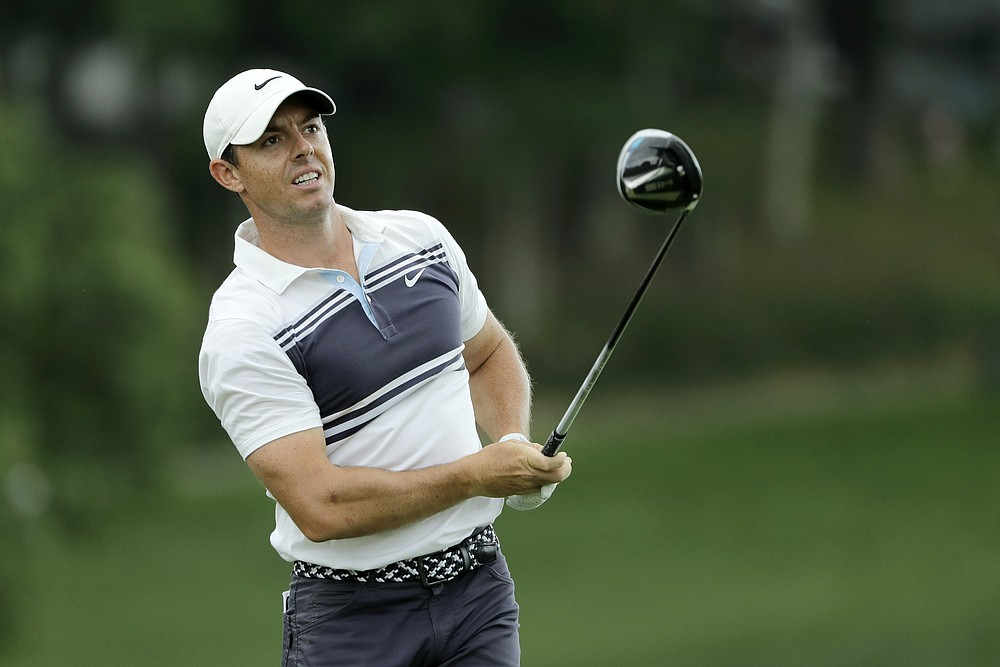 Rory McIlroy, of Northern Ireland, watches his tee shot on the 18th hole during the second round of the Travelers Championship golf tournament at TPC River Highlands, Friday, June 26, 2020, in Cromwell, Conn. (AP Photo/Frank Franklin II)
